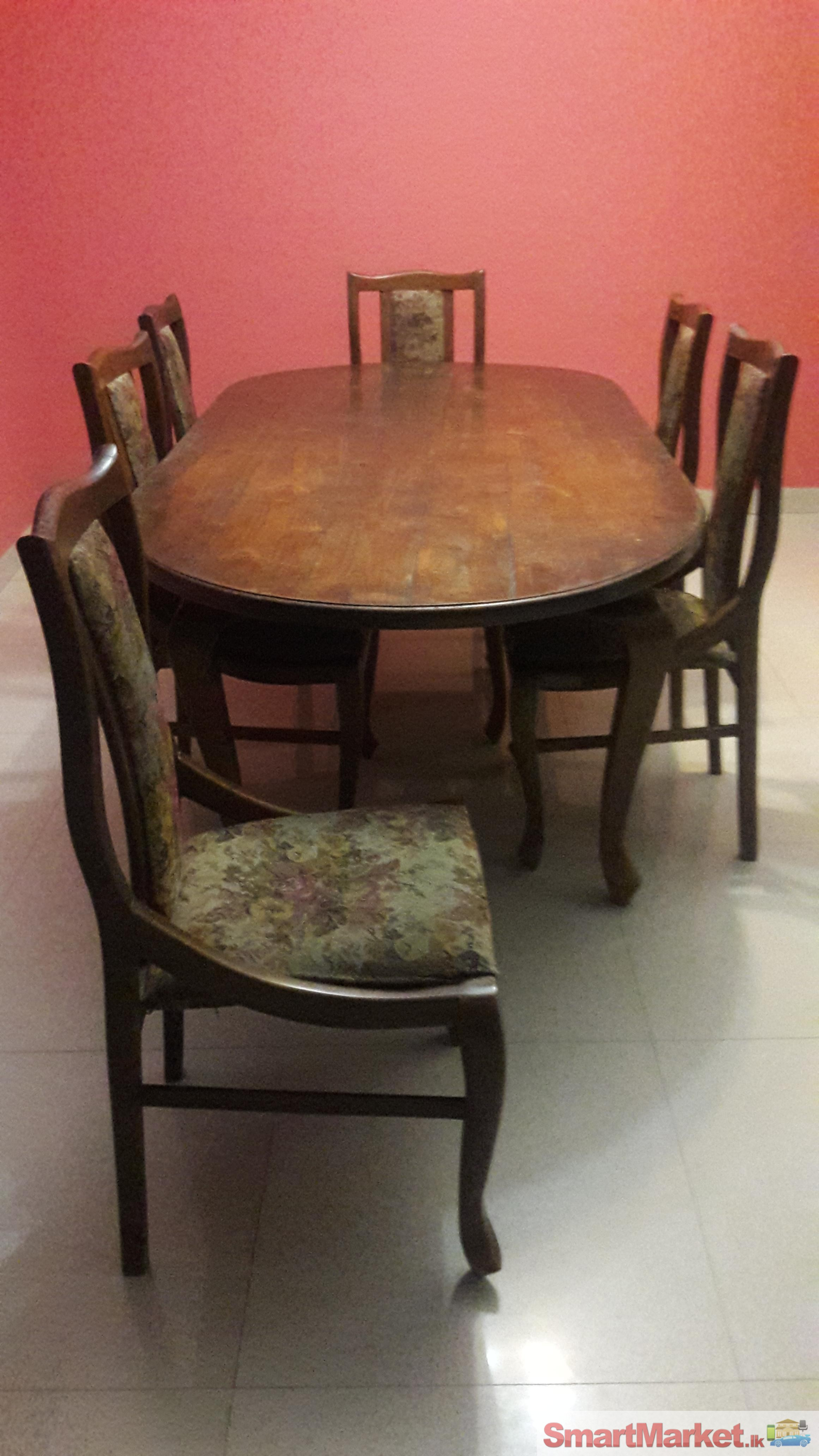 used teak dining table and 6 chairs