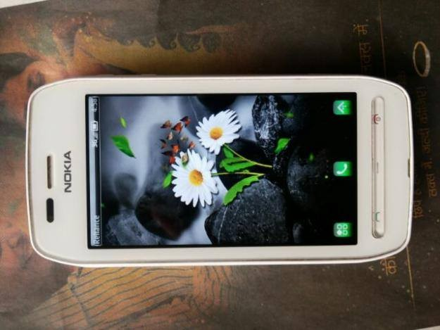 nokia 603///1 gz /512 ram/5mp cam/ full set 99% back 100%
